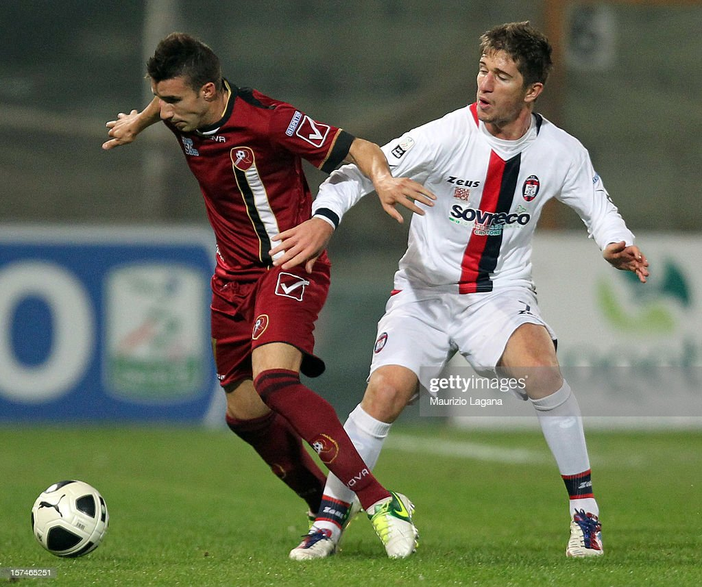Antonino Barilla' (L) of Reggina competes for the ball with Stefano Pettinari of Crotone during the Serie B match between Reggina Calcio and FC Crotone at Stadio Oreste Granillo on December 3, 2012 in Reggio Calabria, Italy.