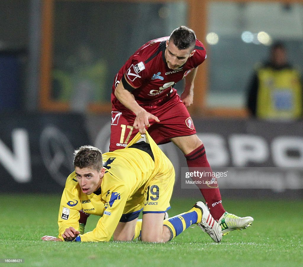 Antonino Barilla' of Reggina pulls on the shorts of Jorginho of Verona during the Serie B match between Reggina Calcio and Hellas Verona at Stadio Oreste Granillo on February 1, 2013 in Reggio Calabria, Italy.