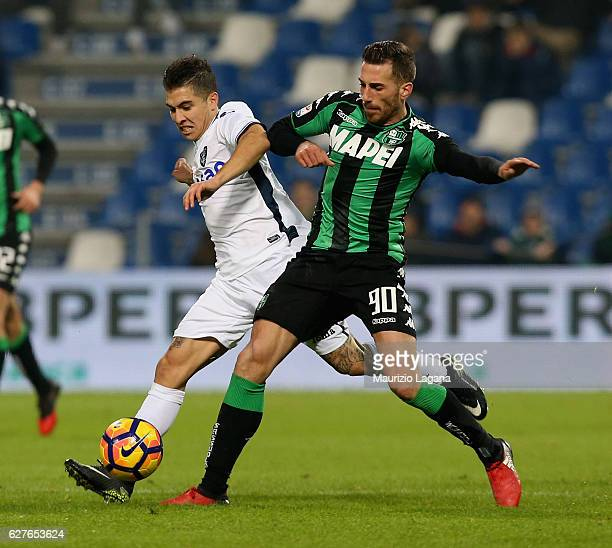 Antonino Ragusa of Sassuolo competes for the ball with Josè Mauri of Empoli during the Serie A match between US Sassuolo and Empoli FC at Mapei...