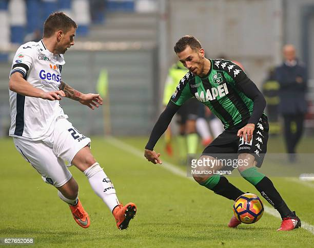 Antonino Ragusa of Sassuolo competes for the ball with Uros Cosic of Empoli during the Serie A match between US Sassuolo and Empoli FC at Mapei...