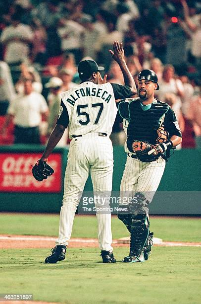 Antonio Alfonseca and Ramon Castro of the Florida Marlins high five during the game against the Arizona Diamondbacks on July 28 2000 at Pro Player...