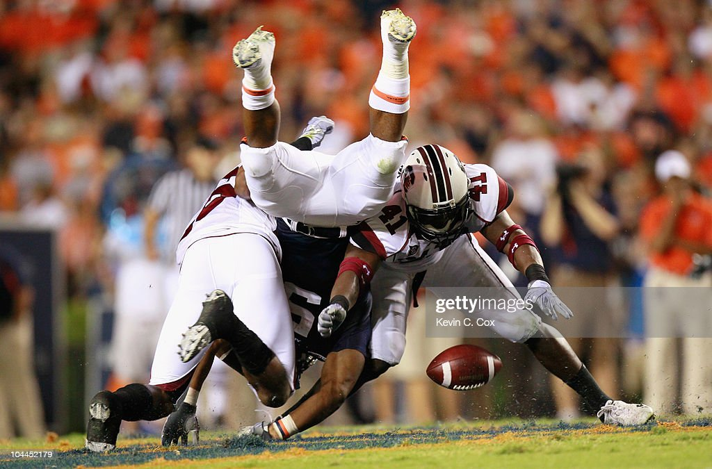 Antonio Allen #26 and Josh Dickerson #41 of the South Carolina Gamecocks force a fumble by Michael Dyer #5 of the Auburn Tigers at Jordan-Hare Stadium on September 25, 2010 in Auburn, Alabama.