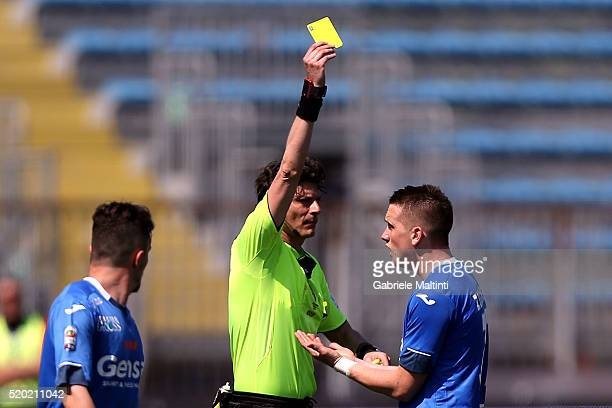 Antonio Amato referee shows the yellow card to Piotr Zielinski of Empoli FC during the Serie A match between Empoli FC and ACF Fiorentina at Stadio...