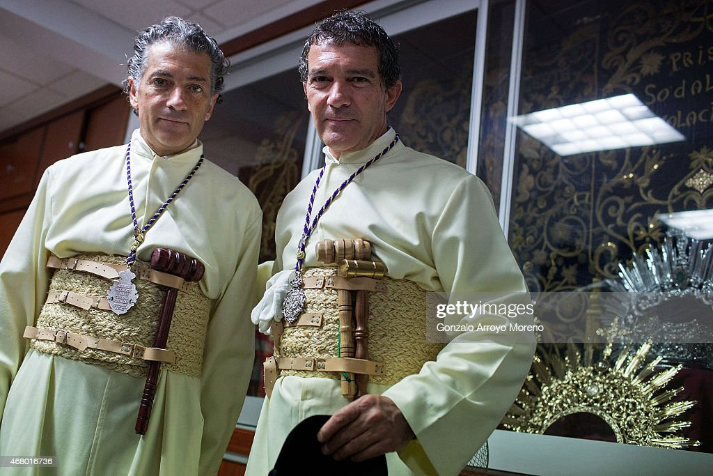 Antonio Banderas (R) and his brother Javier Dominguez Banderas (L) pose for apicture as they attend the Maria Santisima de Lagrimas y Favores procession at San Juan Bautista church during Holy Week celebrations on March 29, 2015 in Malaga, Spain.