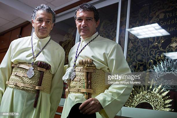 Antonio Banderas and his brother Javier Dominguez Banderas pose for apicture as they attend the Maria Santisima de Lagrimas y Favores procession at...