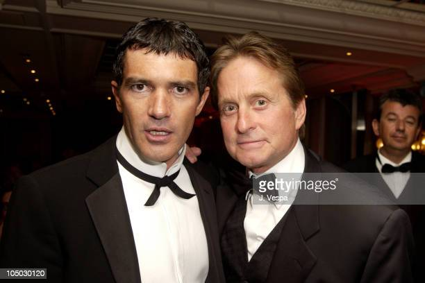 Antonio Banderas and Michael Douglas during Cannes 2002 'Femme Fatale' Dinner at Le Dome Carlton Hotel in Cannes France