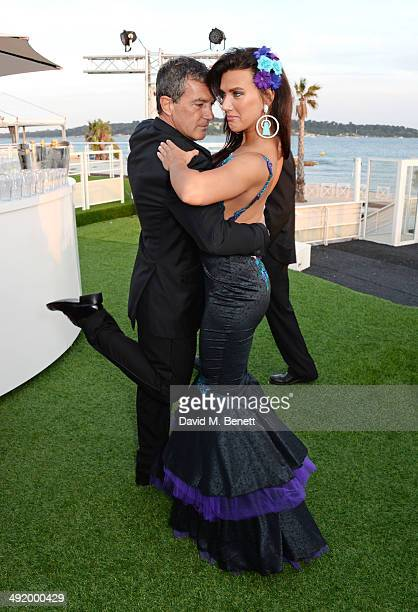 Antonio Banderas and Natalie Burn dance at 'The Expendables 3' private dinner and party at Gotha Night Club at Palm Beach on May 18 2014 in Cannes...