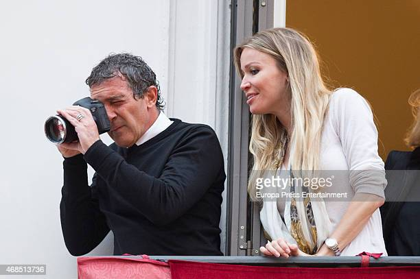 Antonio Banderas and Nicole Kimpel attend procesion during Holy Week celebration on April 2 2015 in Malaga Spain