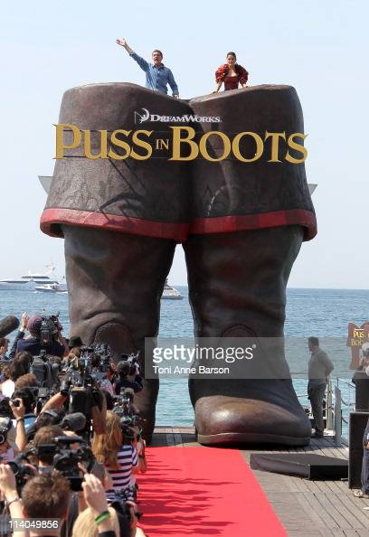 Antonio Banderas and Salma Hayek attend the 'Puss In Boots' Photocall at the Carlton Beach during the 64th Cannes Film Festival on May 11 2011 in...
