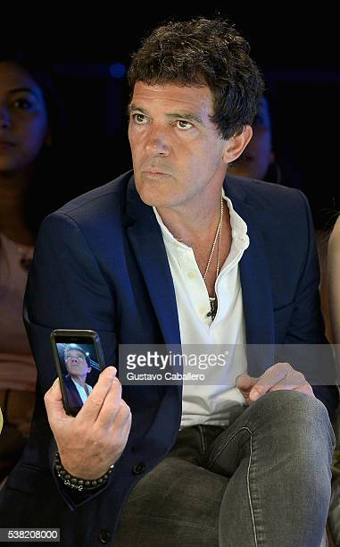 Antonio Banderas attends the Miami Fashion Week Day 3 Front Row And Backstage Highlights fron row during the show at Miami Fashion Week at Ice Palace...