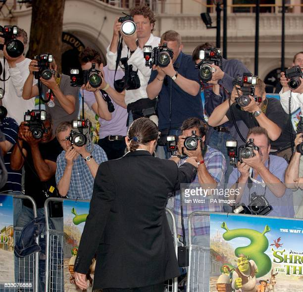 Antonio Banderas poses for photographers as he arrives for the UK Premiere of Shrek The Third at the Odeon Cinema in Leicester Square central London