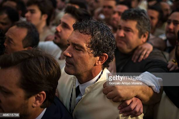 Antonio Banderas thrills as he sings to Maria Santisima de Lagrimas y Favores trone with his mates prior to start its procession at San Juan Bautista...