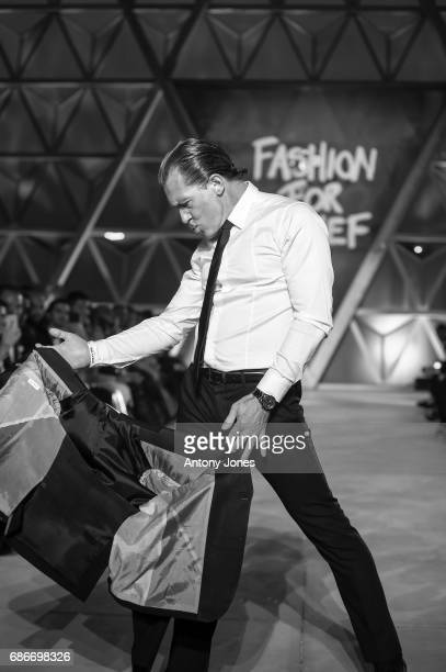 Antonio Banderas walks the runway at the Fashion for Relief event during the 70th annual Cannes Film Festival at on May 21 2017 in Cannes France