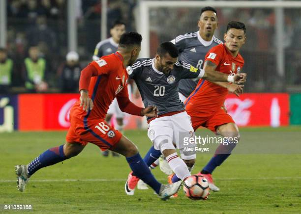 Antonio Bareiro of Paraguay fights for the ball with Charles Aranguiz of Chile during a match between Chile and Paraguay as part of FIFA 2018 World...
