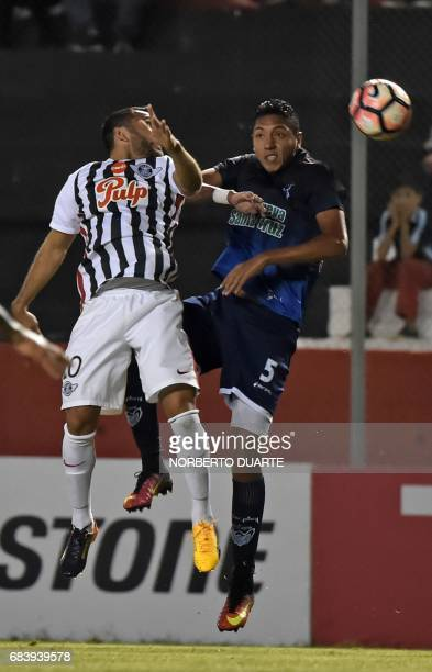 Antonio Bareiro of Paraguay's Libertad and Samuel Galindo of Bolivia's Sport Boys jump for the ball during their 2017 Copa Libertadores football...