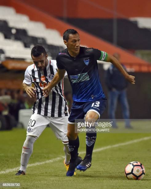 Antonio Bareiro of Paraguay's Libertad vies for the ball with Rosauro Rivero of Bolivia's Sport Boys during their 2017 Copa Libertadores football...