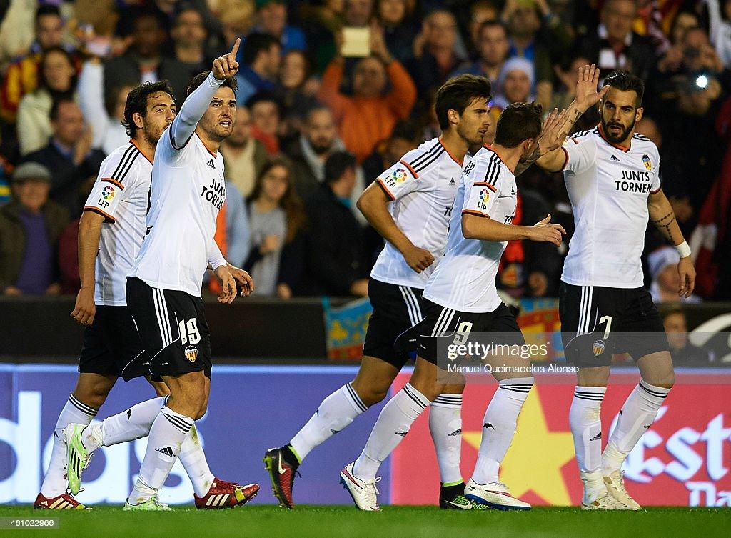 Antonio Barragan of Valencia celebrates after scoring with his teammates during the La Liga match between Valencia CF and Real Madrid CF at Estadi de...