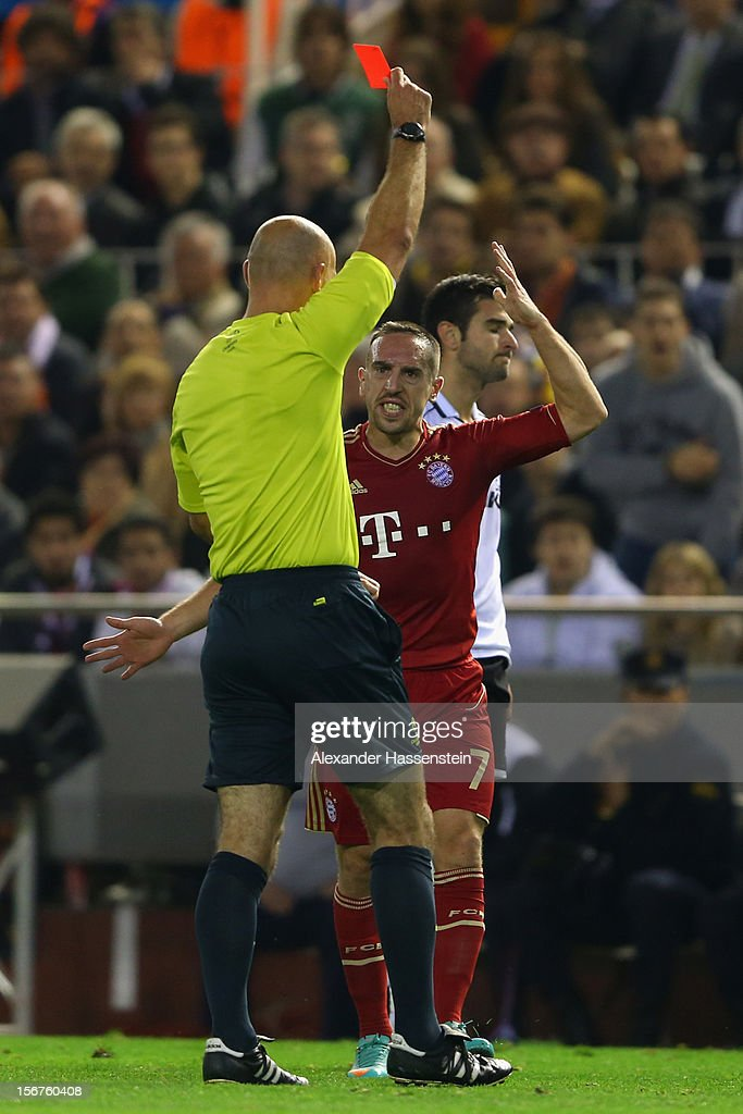 Antonio Barragan (R) of Valencia receives the Red card from referee Howard Webb during the UEFA Champions League group F match between Valencia FC and FC Bayern Muenchen at Estadio Mestalla on November 20, 2012 in Valencia, Spain.