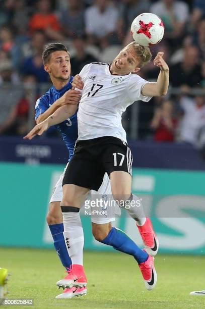 Antonio Barreca Mitchell Weiser during the UEFA U21 European Championship Group C football match Italy v Germany in Krakow Poland on June 24 2017