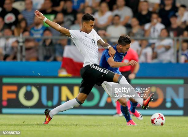 Antonio Barreca of Italy is challenged by Davie Selke of Germany during the UEFA European Under21 Championship Group C match between Italy and...