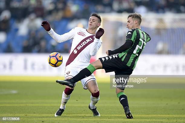 Antonio Barreca of Torino FC and Federico Ricci of US Sassuolo compete for the ball during the Serie A football match between US Sassuolo and Torino...