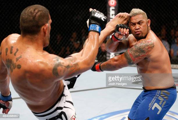 Antonio 'Bigfoot' Silva kicks Mark Hunt in their heavyweight fight during the UFC Fight Night event at the Brisbane Entertainment Centre on December...