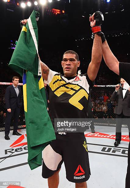 Antonio 'Bigfoot' Silva of Brazil celebrates his victory over Soa Palelei of Australia in their heavyweight bout during the UFC 190 event inside HSBC...