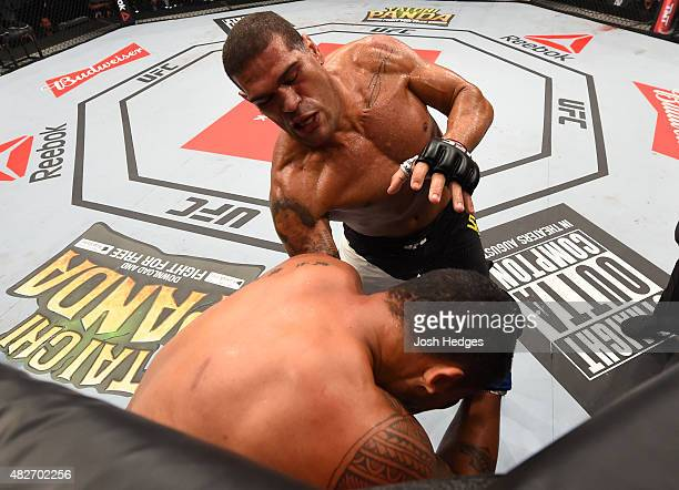 Antonio 'Bigfoot' Silva of Brazil punches Soa Palelei of Australia in their heavyweight bout during the UFC 190 event inside HSBC Arena on August 1...