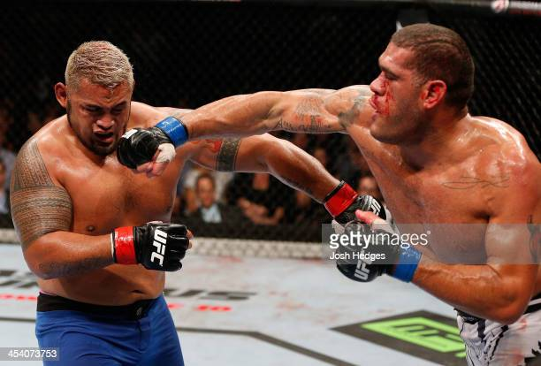 Antonio 'Bigfoot' Silva punches Mark Hunt in their heavyweight fight during the UFC Fight Night event at the Brisbane Entertainment Centre on...