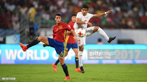 Antonio Blanco of Spain challenges Mohammad Ghaderi of Iran during the FIFA U17 World Cup India 2017 Quarter Final match between Spain and Iran at...