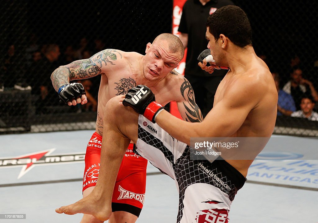 Antonio Braga Neto knees Anthony Smith in their middleweight fight during the UFC on FUEL TV event at Paulo Sarasate Arena on June 8, 2013 in Fortaleza, Ceara, Brazil.