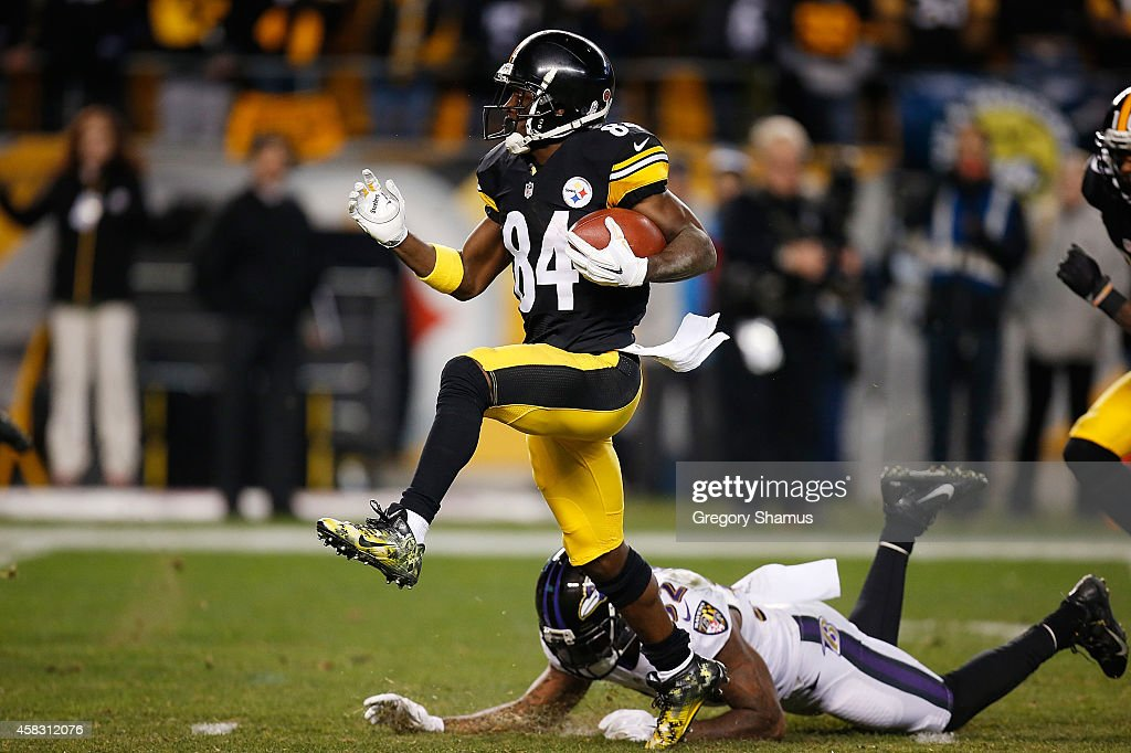 Antonio Brown #84 of the Pittsburgh Steelers avoids a tackle Dominique Franks #32 of the Baltimore Ravens and scores a 54 yard touchdown during the fourth quarter at Heinz Field on November 2, 2014 in Pittsburgh, Pennsylvania.
