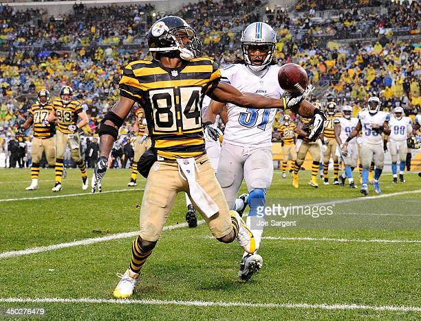 Antonio Brown of the Pittsburgh Steelers can't make a catch in front of Rashean Mathis of the Detroit Lions on November 17 2013 at Heinz Field in...