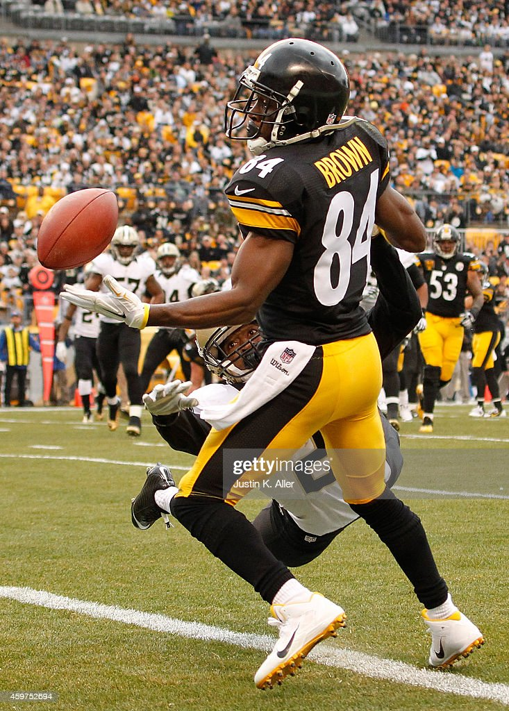 Antonio Brown #84 of the Pittsburgh Steelers can't make a catch in front of Patrick Robinson #21 of the New Orleans Saints during the second quarter at Heinz Field on November 30, 2014 in Pittsburgh, Pennsylvania.