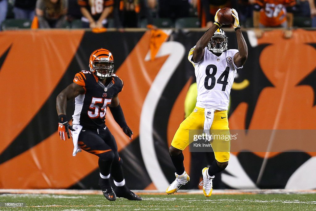 Antonio Brown #84 of the Pittsburgh Steelers catches a pass in front of <a gi-track='captionPersonalityLinkClicked' href=/galleries/search?phrase=Vontaze+Burfict&family=editorial&specificpeople=7173056 ng-click='$event.stopPropagation()'>Vontaze Burfict</a> #55 of the Cincinnati Bengals during the fourth quarter on September 16, 2013 at Paul Brown Stadium on September 16, 2013 in Cincinnati, Ohio. Cincinnati defeated Pittsburgh 20-10.