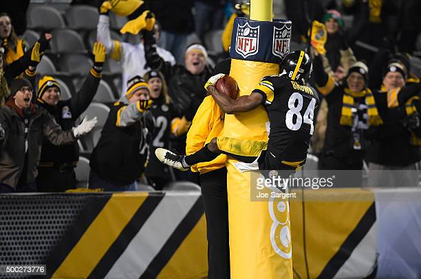 Antonio Brown of the Pittsburgh Steelers celebrates a fourth quarter touchdown by jumping on the goal post during the game against the Indianapolis...