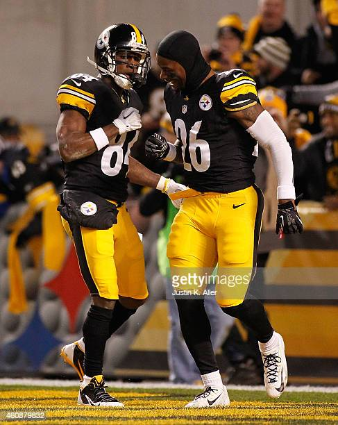 Antonio Brown of the Pittsburgh Steelers celebrates his punt return for a touchdown with Le'Veon Bell during the first quarter against the Cincinnati...