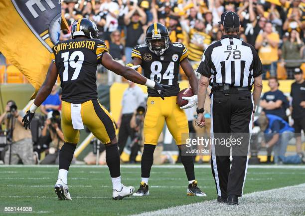 Antonio Brown of the Pittsburgh Steelers celebrates his sevenyard touchdown reception in the first quarter with JuJu SmithSchuster against the...