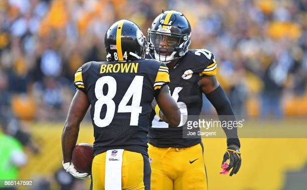 Antonio Brown of the Pittsburgh Steelers celebrates his sevenyard touchdown reception in the first quarter with Le'Veon Bell during the game against...