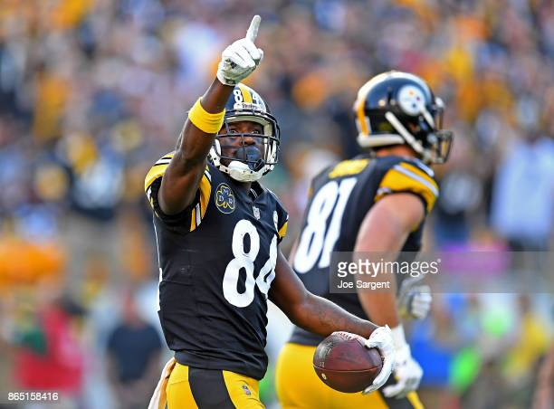 Antonio Brown of the Pittsburgh Steelers celebrates his sevenyard touchdown reception in the first quarter during the game against the Cincinnati...