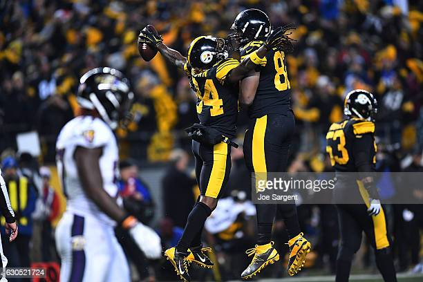 Antonio Brown of the Pittsburgh Steelers celebrates with David Johnson after catching a 4 yard touchdown pass in the fourth quarter during the game...