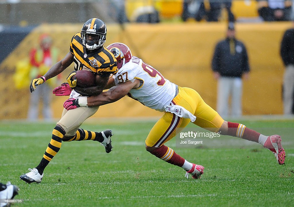 Antonio Brown #84 of the Pittsburgh Steelers gets wrapped up by <a gi-track='captionPersonalityLinkClicked' href=/galleries/search?phrase=Lorenzo+Alexander&family=editorial&specificpeople=772505 ng-click='$event.stopPropagation()'>Lorenzo Alexander</a> #97 of the Washington Redskins on October 28, 2012 at Heinz Field in Pittsburgh, Pennsylvania. Pittsburgh won the game 27-12.