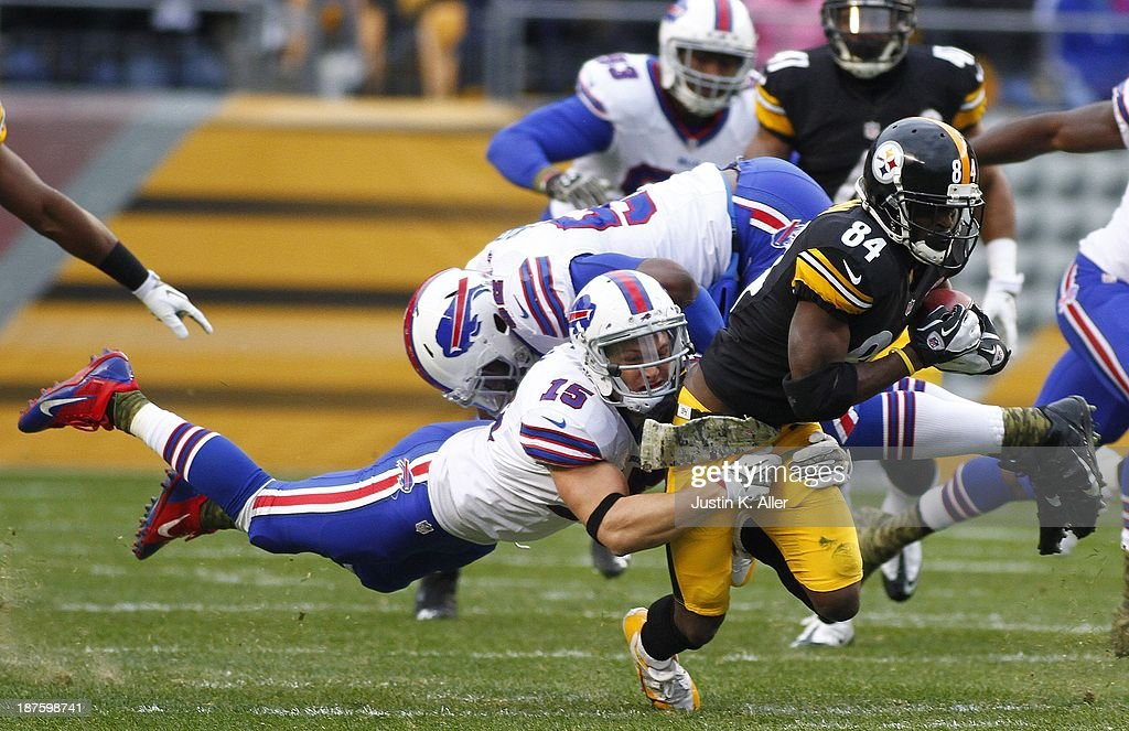 Antonio Brown #84 of the Pittsburgh Steelers is tackled by Chris Hogan #15 of the Buffalo Bills during the game on November 10, 2013 at Heinz Field in Pittsburgh, Pennsylvania.
