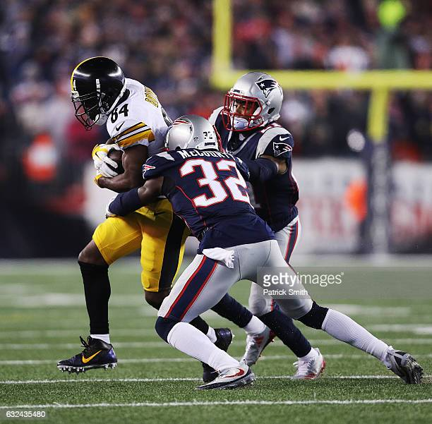 Antonio Brown of the Pittsburgh Steelers is tackled by Devin McCourty of the New England Patriots during the third quarter in the AFC Championship...