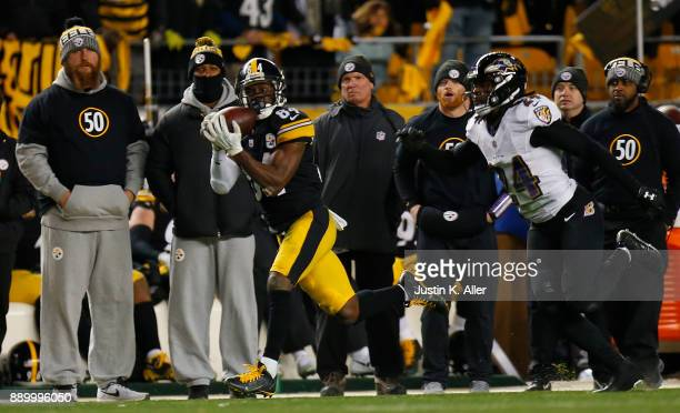 Antonio Brown of the Pittsburgh Steelers makes a catch in front of Brandon Carr of the Baltimore Ravens in the fourth quarter during the game at...