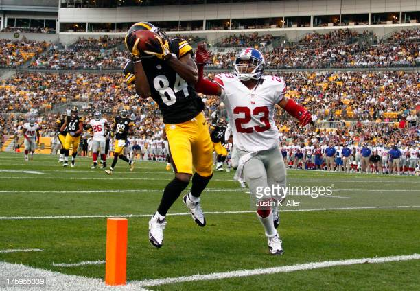 Antonio Brown of the Pittsburgh Steelers makes a catch in the end zone that was over turned as a touchdown in the first half against Corey Webster of...