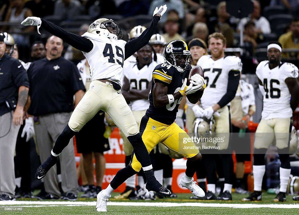 Antonio Brown #84 of the Pittsburgh Steelers pulls in a reception over De'Vante Harris #49 of the New Orleans Saints for a 57-yard touchdown during the first half of a game at the Mercedes-Benz Superdome on August 26, 2016 in New Orleans, Louisiana.