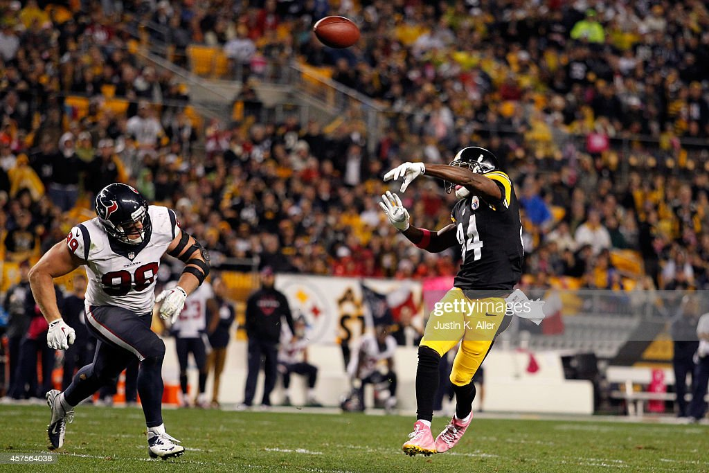 Antonio Brown #84 of the Pittsburgh Steelers throws a touchdown pass to Lance Moore #16 in the second quarter against the Houston Texans during their game at Heinz Field on October 20, 2014 in Pittsburgh, Pennsylvania.