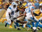 Antonio Brown of the Pittsburgh Steelers tries to get past the tackle of Nick Fairley of the Detroit Lions at Heinz Field on November 17 2013 in...