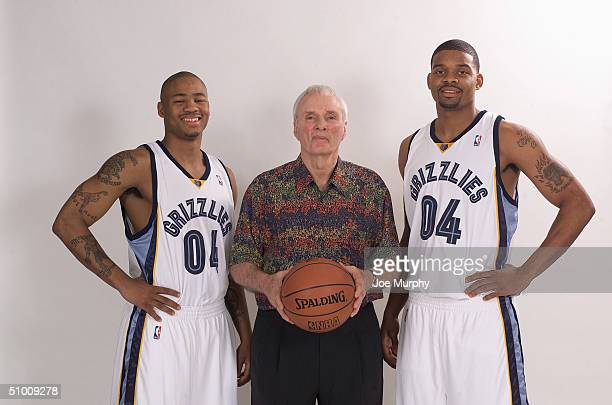 Antonio Burks and Andre Emmett both 2004 draft picks of the Memphis Grizzlies pose for a portrait with Head Coach Hubie Brown on June 25 2004 in...